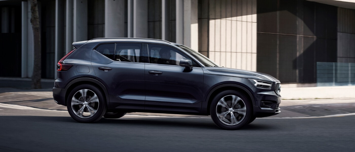New Volvo XC40 Side exterior view driving through the city