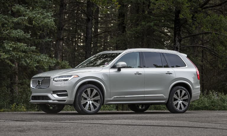 Volvo XC90 parked outside by the woods