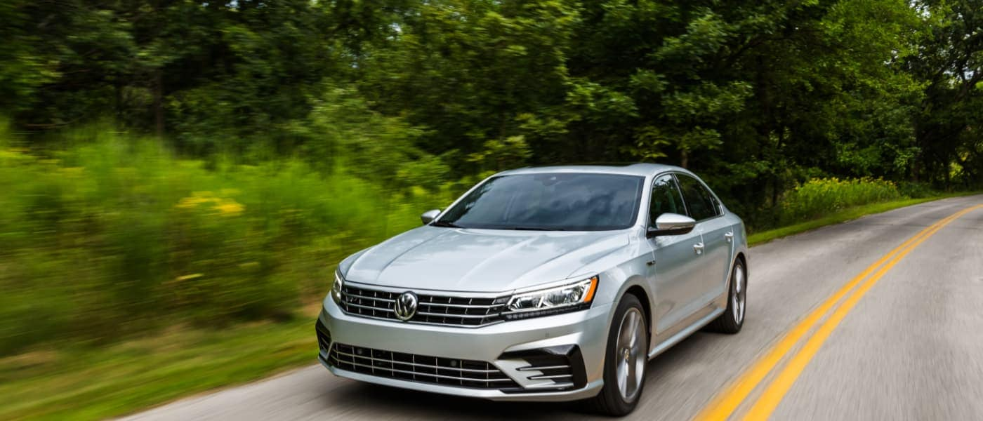 2019 Silver VW Passat Driving by Trees
