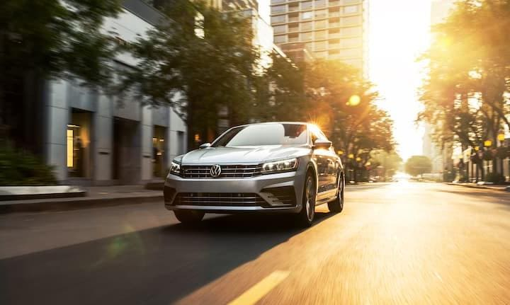 2019 Silver VW Passat Driving at Sunset