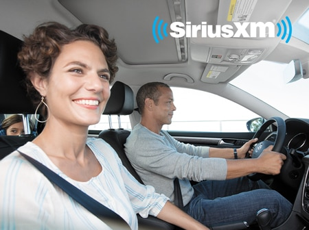 A family riding in their Volkswagne vehicle with SiriusXM radio