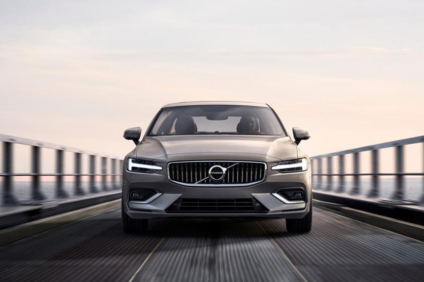2021 Volvo S60 driving on a bridge in Stuart, FL during the evening.