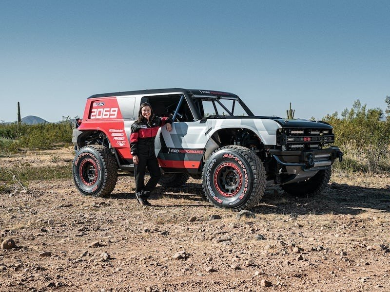 A woman standing next to a 2021 Ford Bronco
