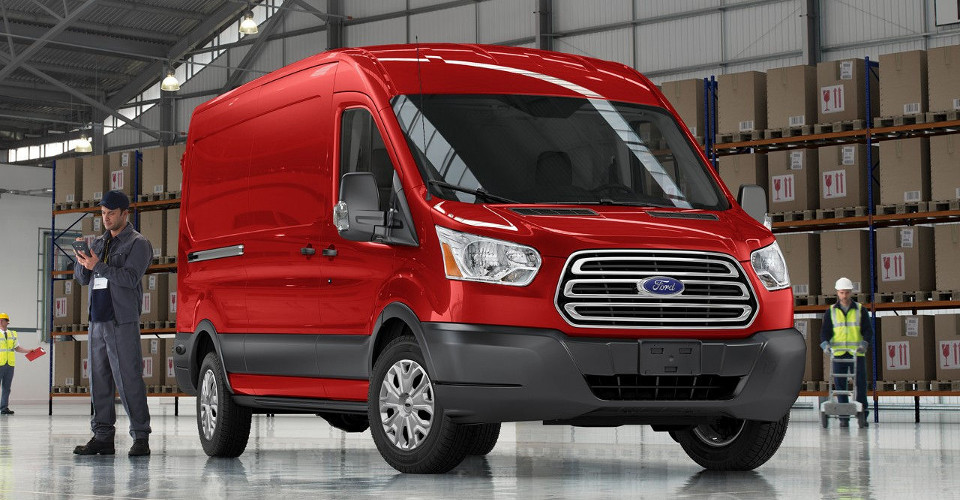 Red 2017 Ford Transit parked in a large warehouse