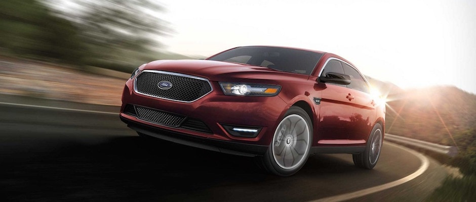 A 2018 Ford Taurus driving down the road