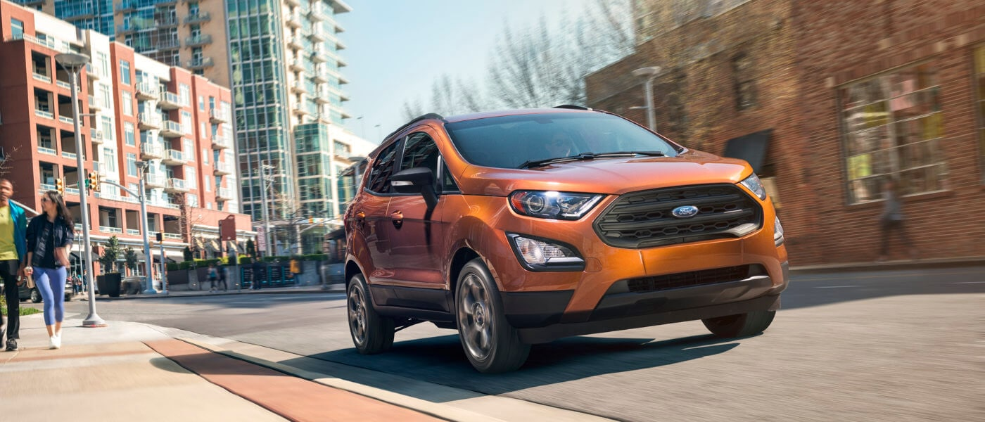 2019 Orange Ford EcoSport Driving Downtown