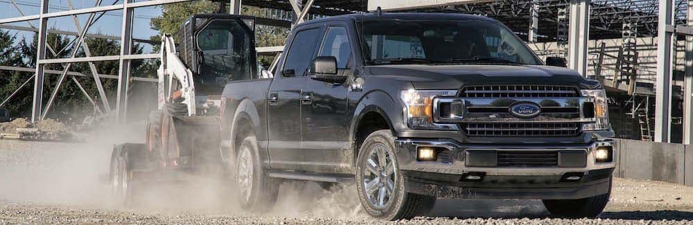 Black 2019 Ford F-150 Towing Construction Equipment