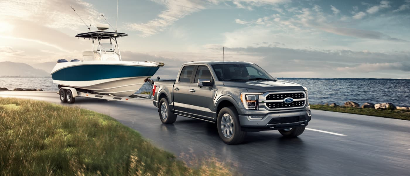 2021 Silver Ford F-150 Towing a Boat