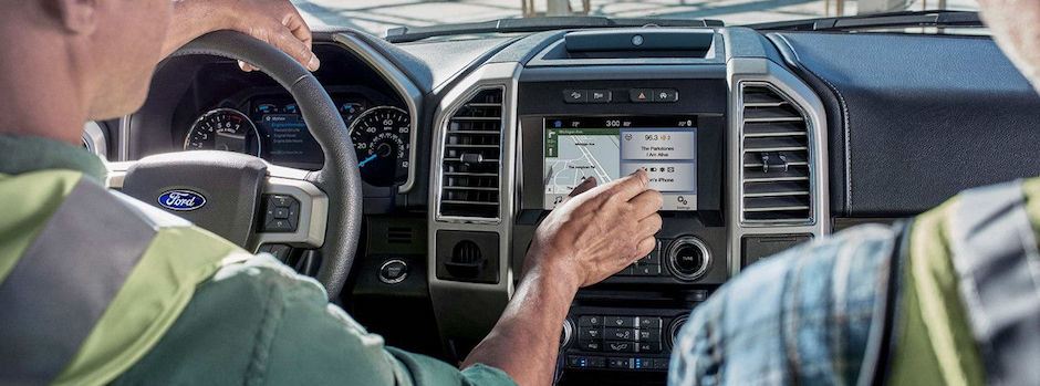 Two construction workers using their Ford SYNC