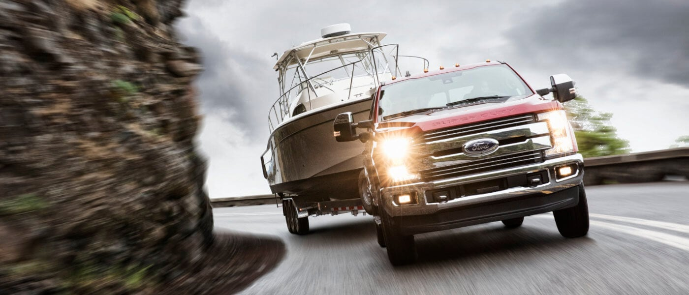 2019 Red Ford F-250 Braking Downhill while Towing a Boat