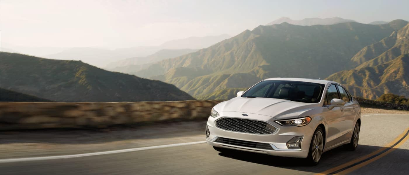 2020 White Ford Fusion Driving through Mountains