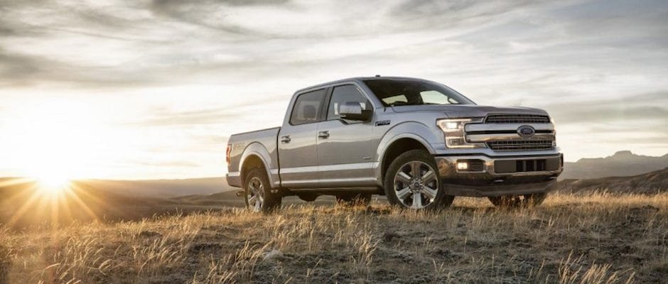 A Ford F-150 parked in a field during sunset