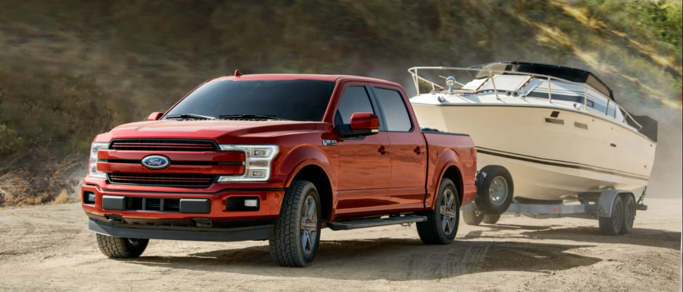 2020 Red Ford F-150 Towing a Boat