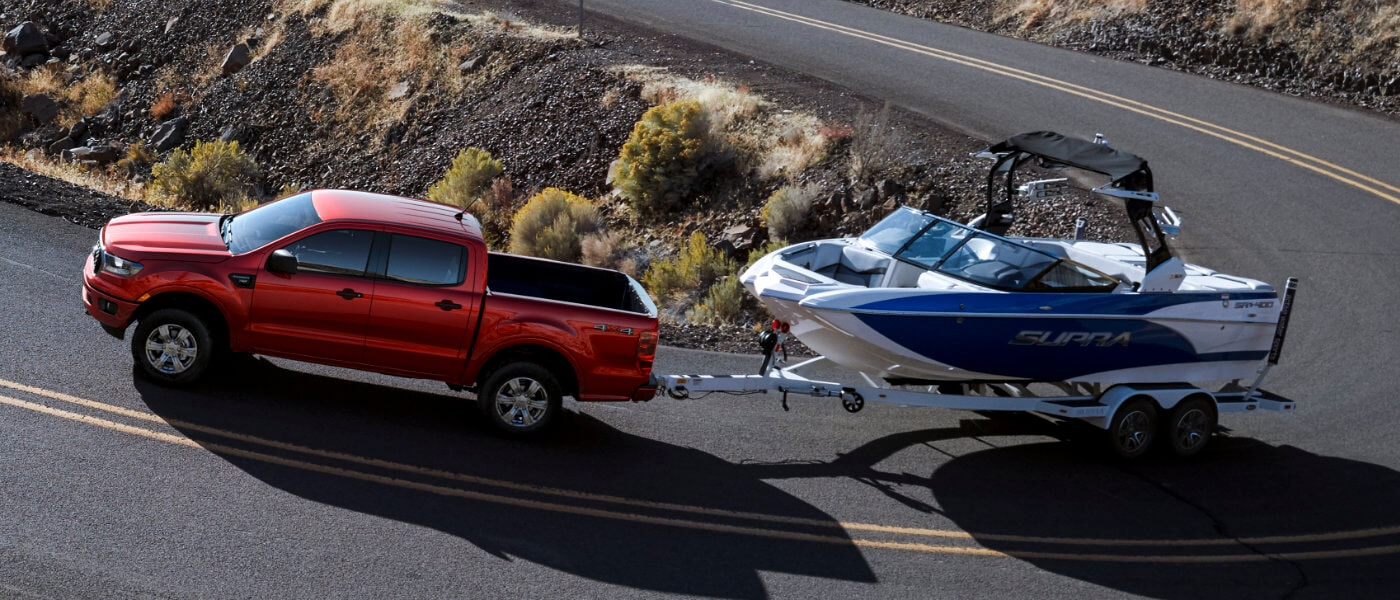 2019 Red Ford Ranger Towing a Boat