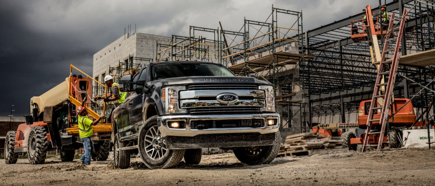 2019 Black Ford F-350 Loading Construction Equipment