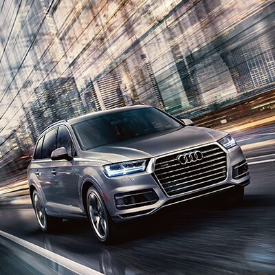Audi Q7 driving down highway