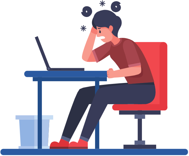 stressed person sitting at a desk looking at a laptop