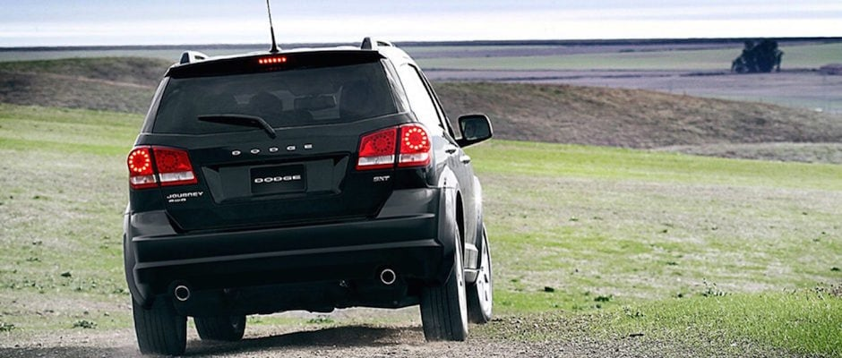 A 2018 Dodge Journey driving through a field