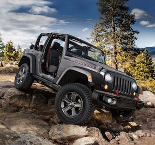 A Jeep Wrangler JK crossing rock terrain