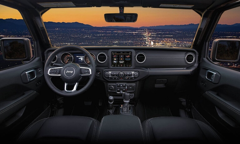 2019 Jeep Wrangler interior overlooking city at night