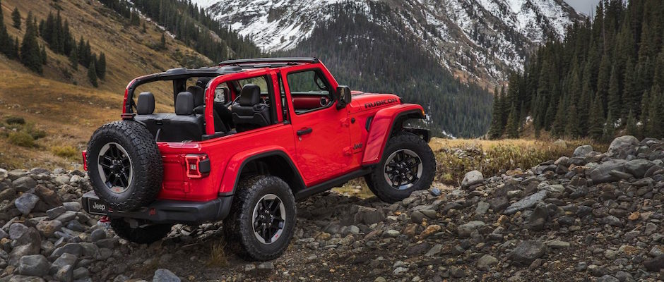 A Red 2018 Jeep Wrangler JL Off Roading