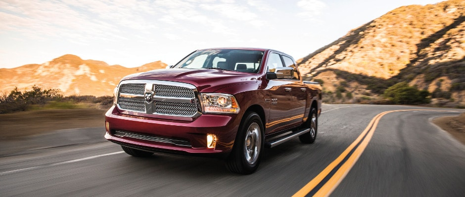 A Ram 1500 driving down an open road