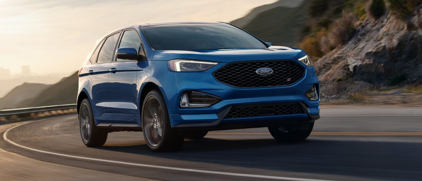 2019 Ford Edge exterior driving in curve at dusk