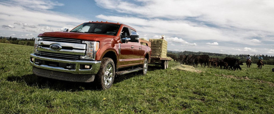 2017 Ford F-250 towing large straw stacks