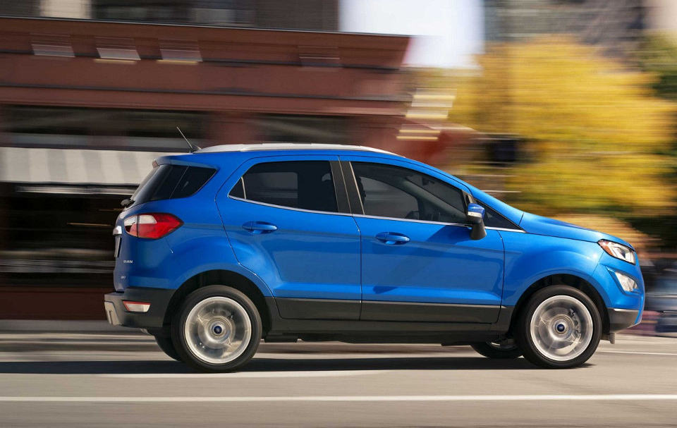 A blue 2018 Ford EcoSport driving sideways to the viewer