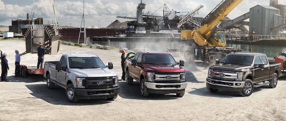 Three Ford Trucks at a construction site