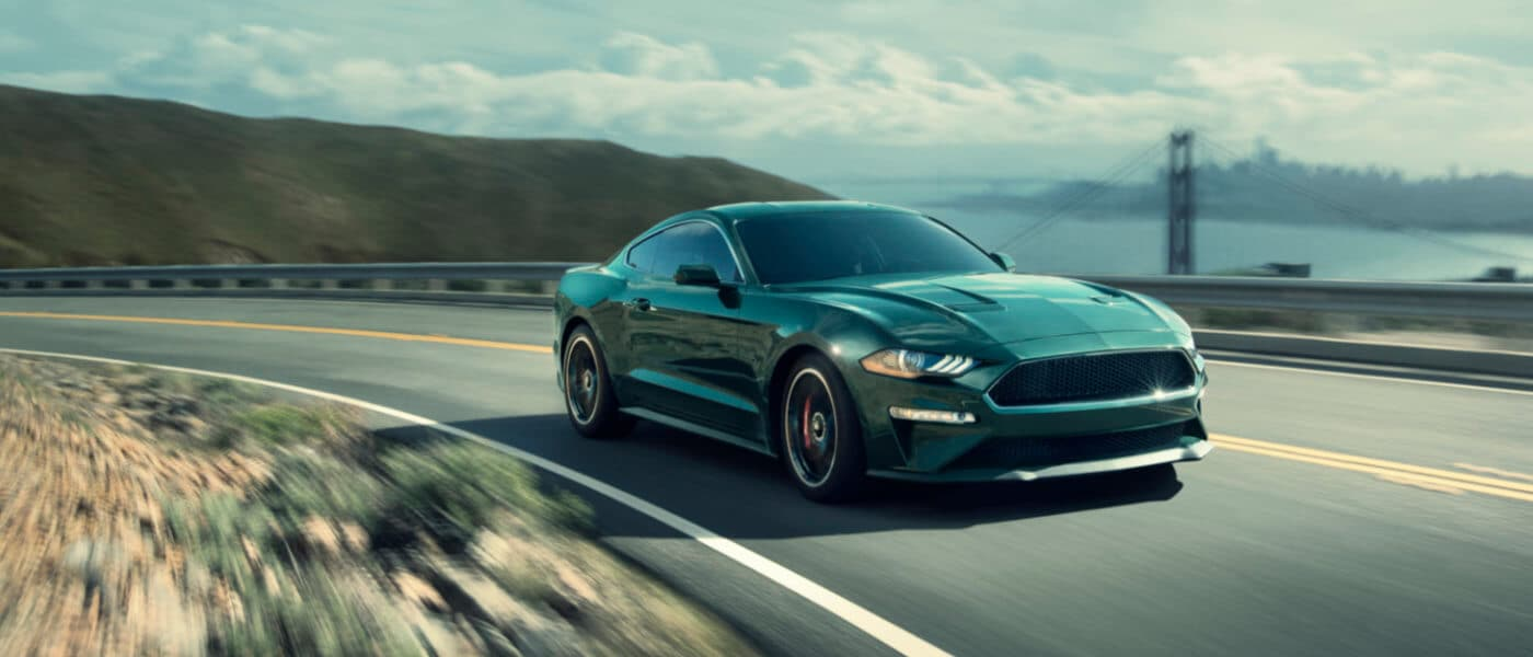 2019 Ford Mustang exterior coast driving with bridge in background