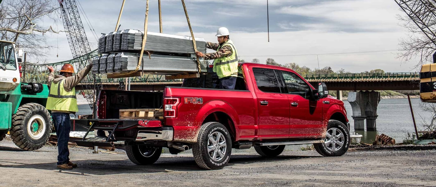 2019 Ford F-150 loading payload onto truck