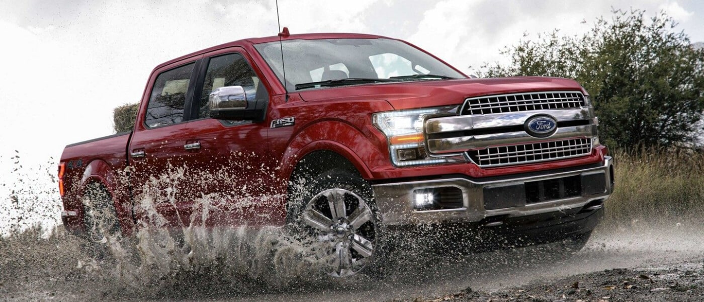 2019 Ford F-150 splashing through mud