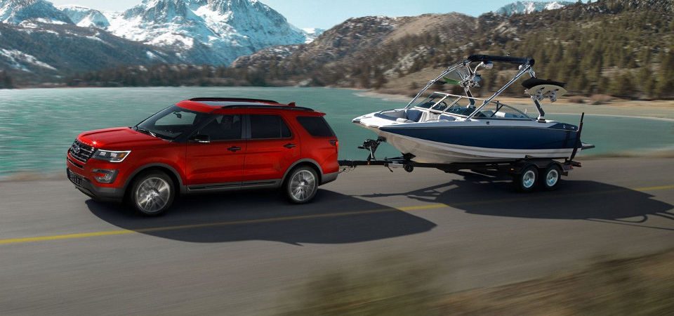 Ford SUV towing a large boat