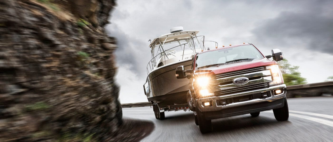 2019 Ford F250 exterior driving around mountain turn towing boat