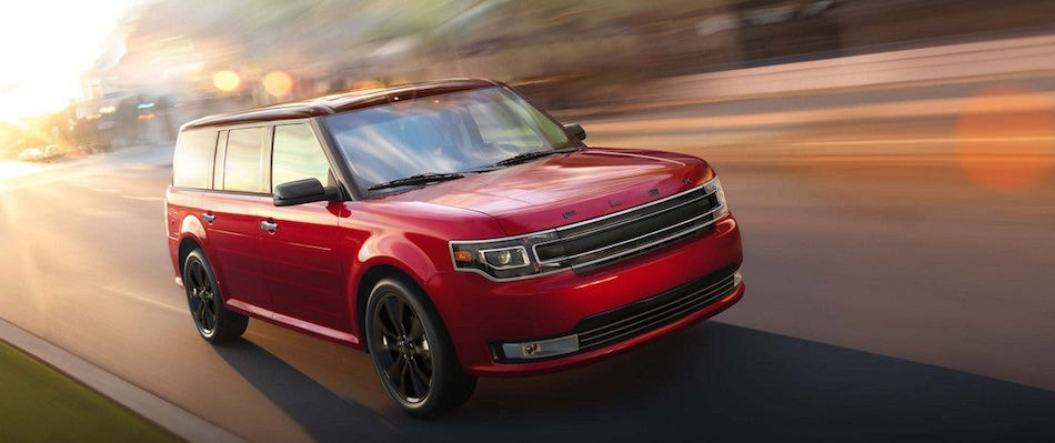 A red 2018 Ford Flex Driving down the highway
