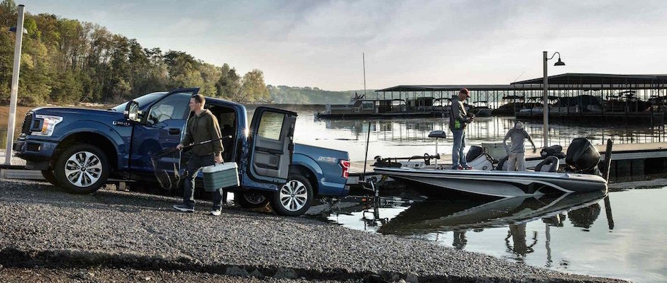 A Family Loading Their Boat Into The Water