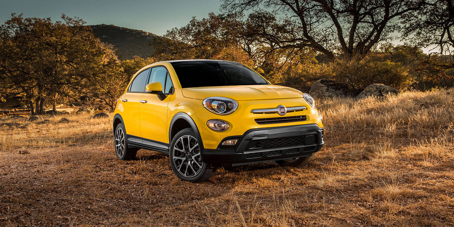 Yellow 2016 FIAT 500X Four Door Crossover SUV Off Road in the Great Outdoors