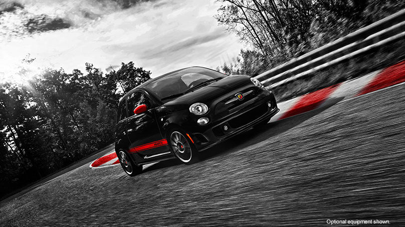 Black 2015 FIAT 500 Abarth Driving on a Racetrack