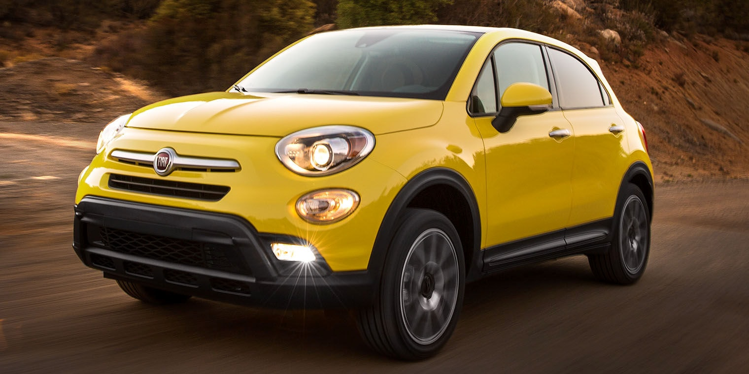 Yellow 2016 FIAT 500X on the road