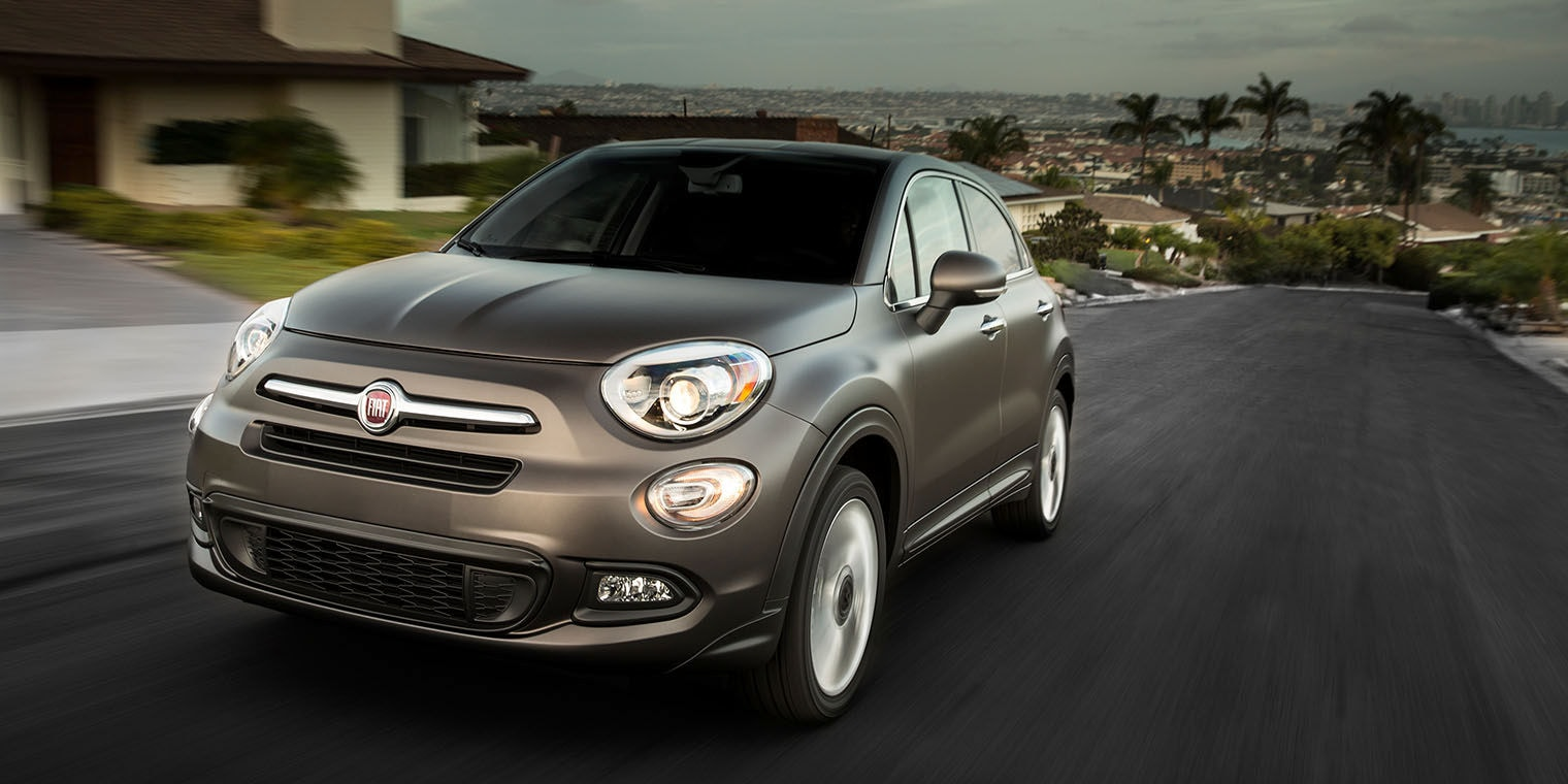 New 2016 FIAT 500X in Gray driving through residential neighborhood
