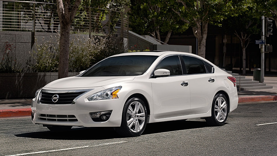 2015 Nissan Altima in Pearl White on the Road