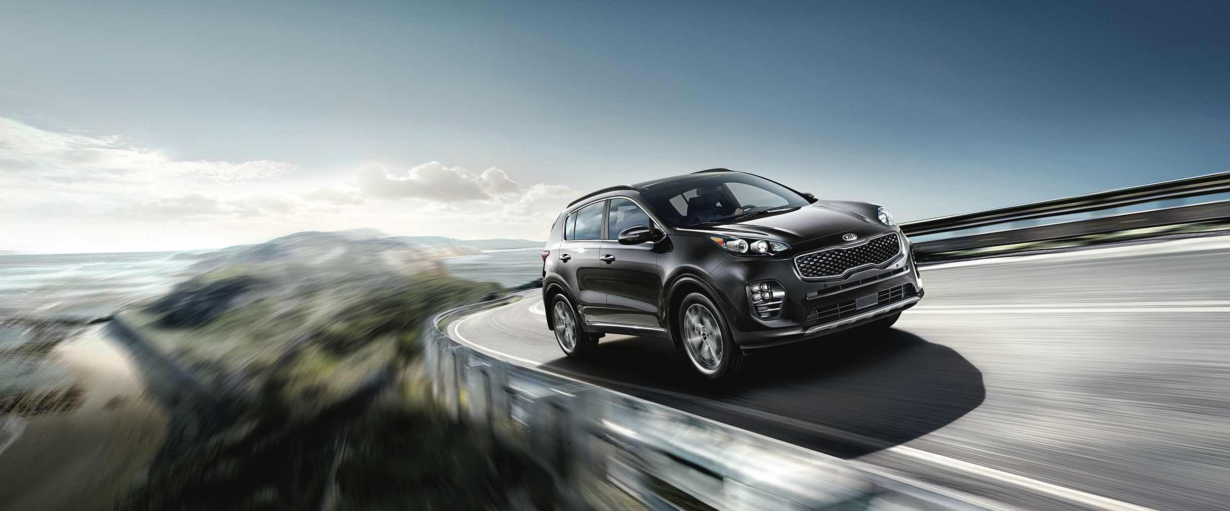2019 Kia Sportage driving on forest road