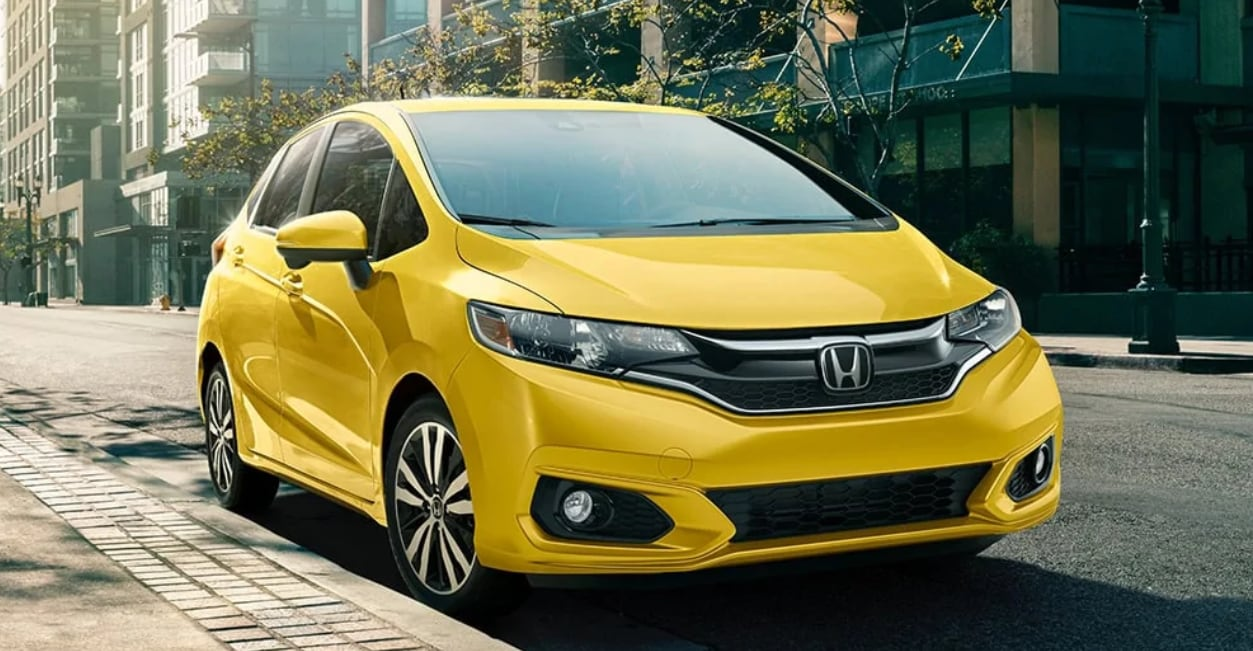 Yellow Honda Fit Sedan