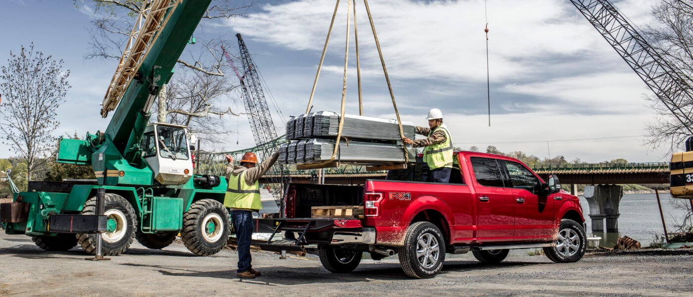 Red 2019 Ford F-150 on construction site