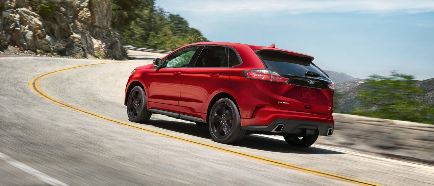 Red 2019 Ford Edge on road